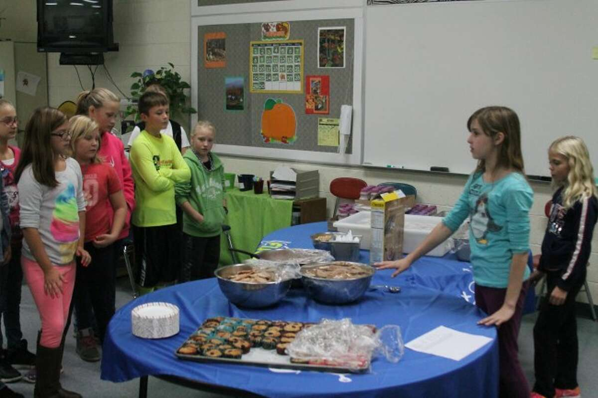 Students who went to Ford Field explain about the healthy foods that they learned about to their classmates. All of the students had the opportunity to try some healthy options on Thursday and then give their feedback on them.