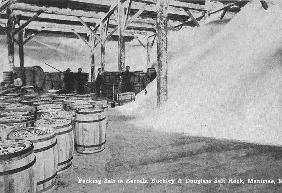 Workers are shown packing salt at the Buckley and Douglas Salt Rock in the early 1890s.