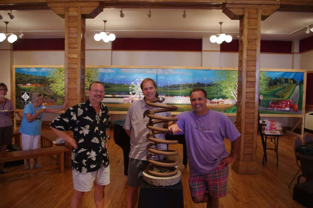 Left to right, artists Bill Hattendorf, Michael Grant and Mark Hoffman exhibited their works over the weekend for the Manistee Art Inistitute at the Ramsdell Theatre for the Three Artists + Series. (Dave Yarnell/News Advocate)