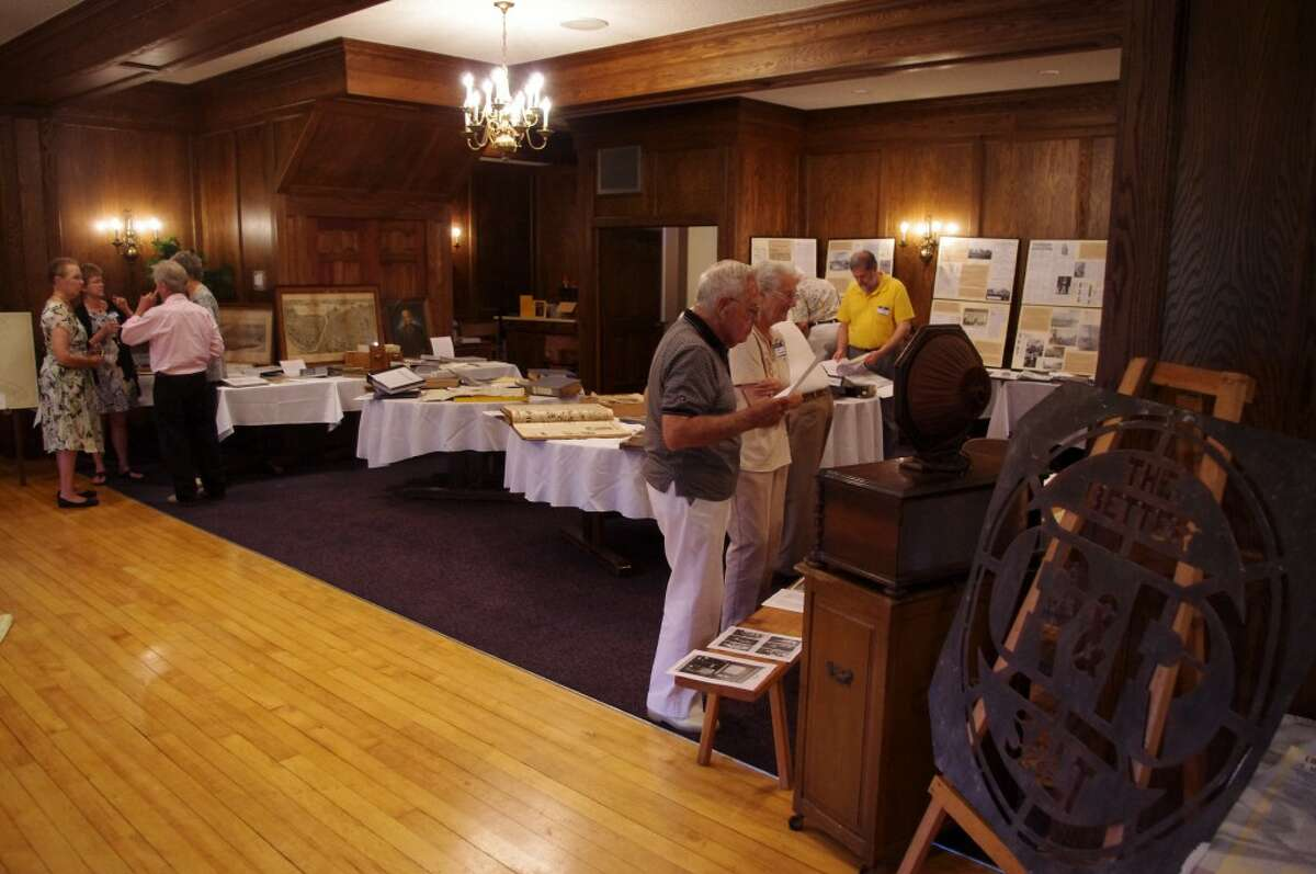 Attendees check out the displays at the Manistee County Historical Museum's Heritage Social. (Dave Yarnell/News Advocate)