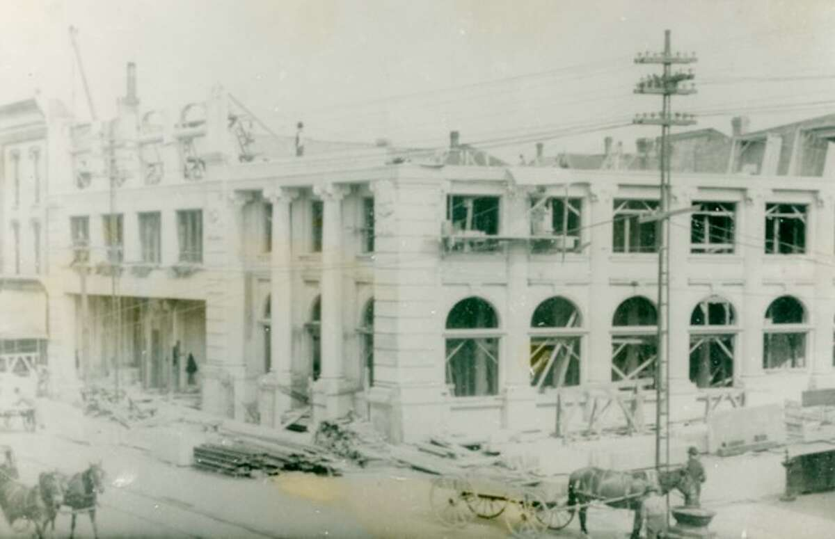 The Manistee County Savings Bank is shown under construction in this early 1900 photograph.