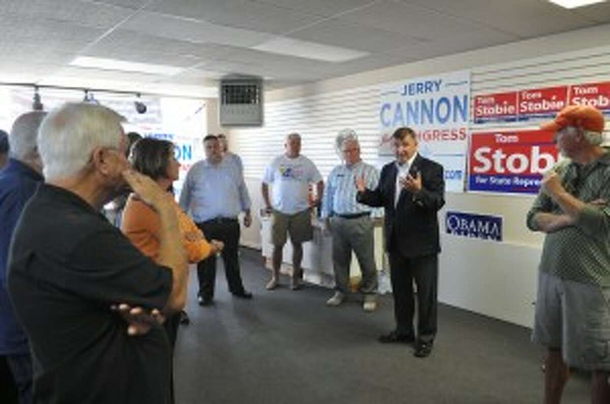 Tom Stobie and Jerry Cannon met with supporters on Thursday at the new Manistee County Democrats office building.