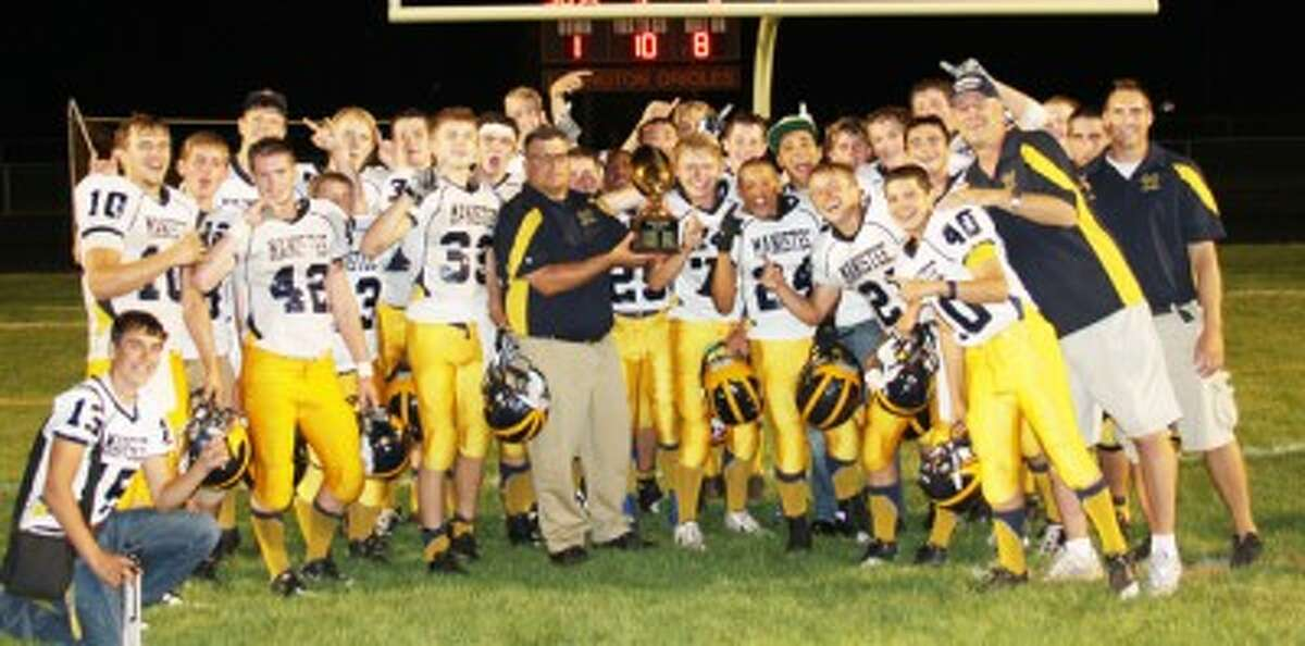 The Chippewas pose with the Dad's Trophy after winning 36-34 at Ludington on Friday night. They will travel to McBain on Thursday. (Matt Wenzel/News Advocate)