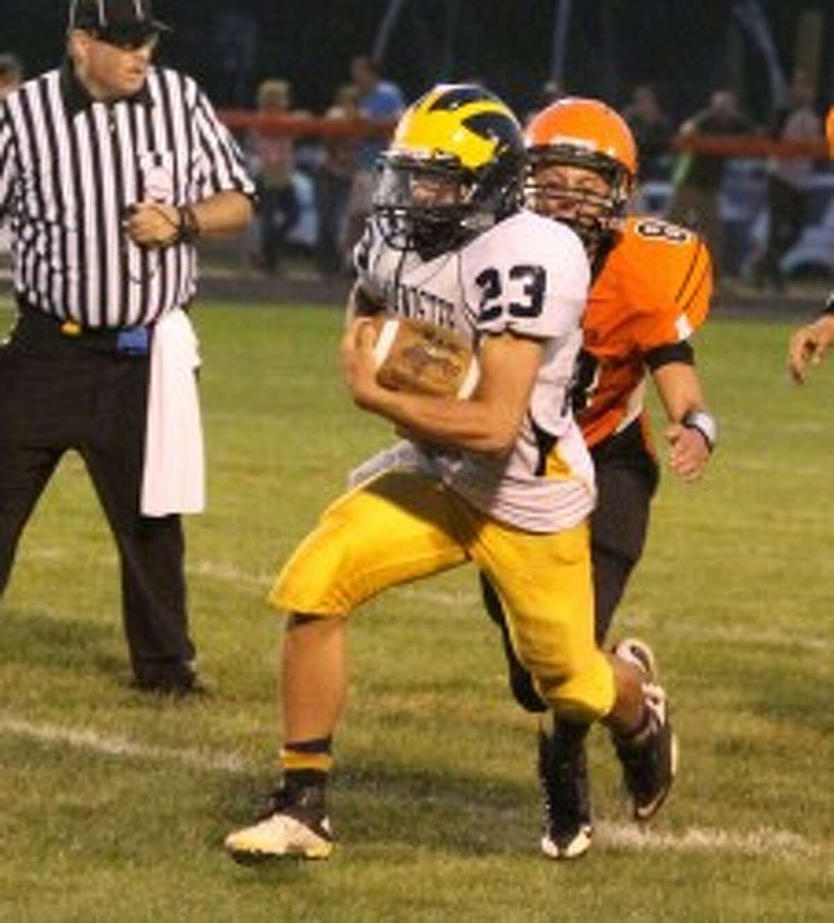 Manistee senior Nick Williams (23) picks up yards in the second half against the Orioles. (Matt Wenzel/News Advocate)