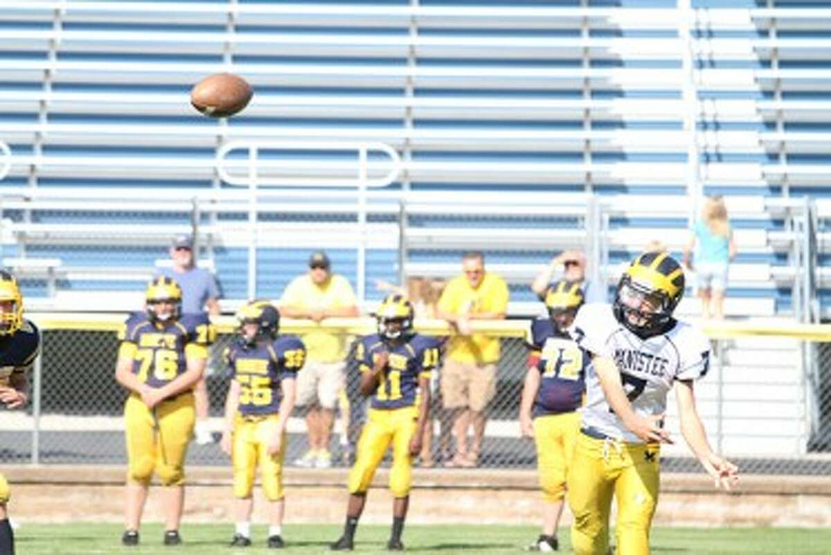 Senior quarterback Tyler Kempf completes a pass on Saturday during Manistee's intrasquad scrimmage. (Matt Wenzel/News Advocate)