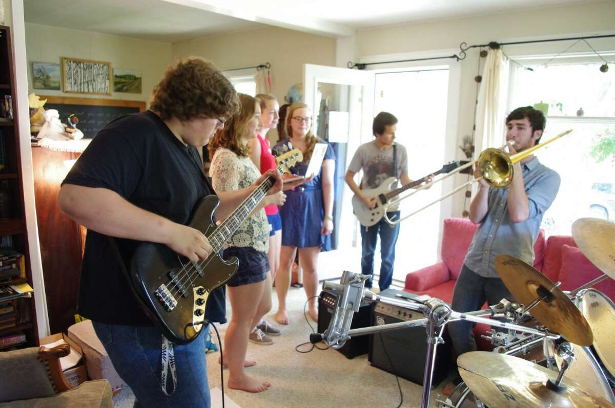 Many of the musicians who will be performing in Friday's Hunger No Longer benefit concert at Onekama's Village Park were rehearsing on Tuesday at the Harvey home in Arcadia. Shown (from left to right) are Morgan Muyskens, Madalyn Harvey, Kaylan Fitch, Emily Barnard, Tucker Laws and Connar Klock. (Dave Yarnell/News Advocate)
