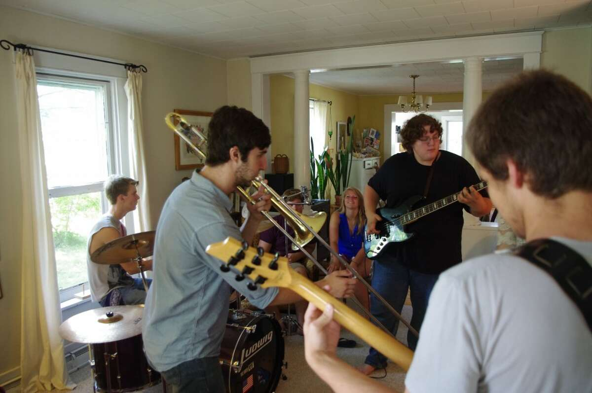 Musicians who will be performing in Friday's Hunger No Longer benefit concert at Onekama's Village Park were rehearsing on Tuesday at the Harvey home in Arcadia. Shown (from left to right) are Josh Ide, Connar Klock, Gerald Eipperle, Anna Brown, Morgan Muyskens and Tucker Laws. (Dave Yarnell/News Advocate)