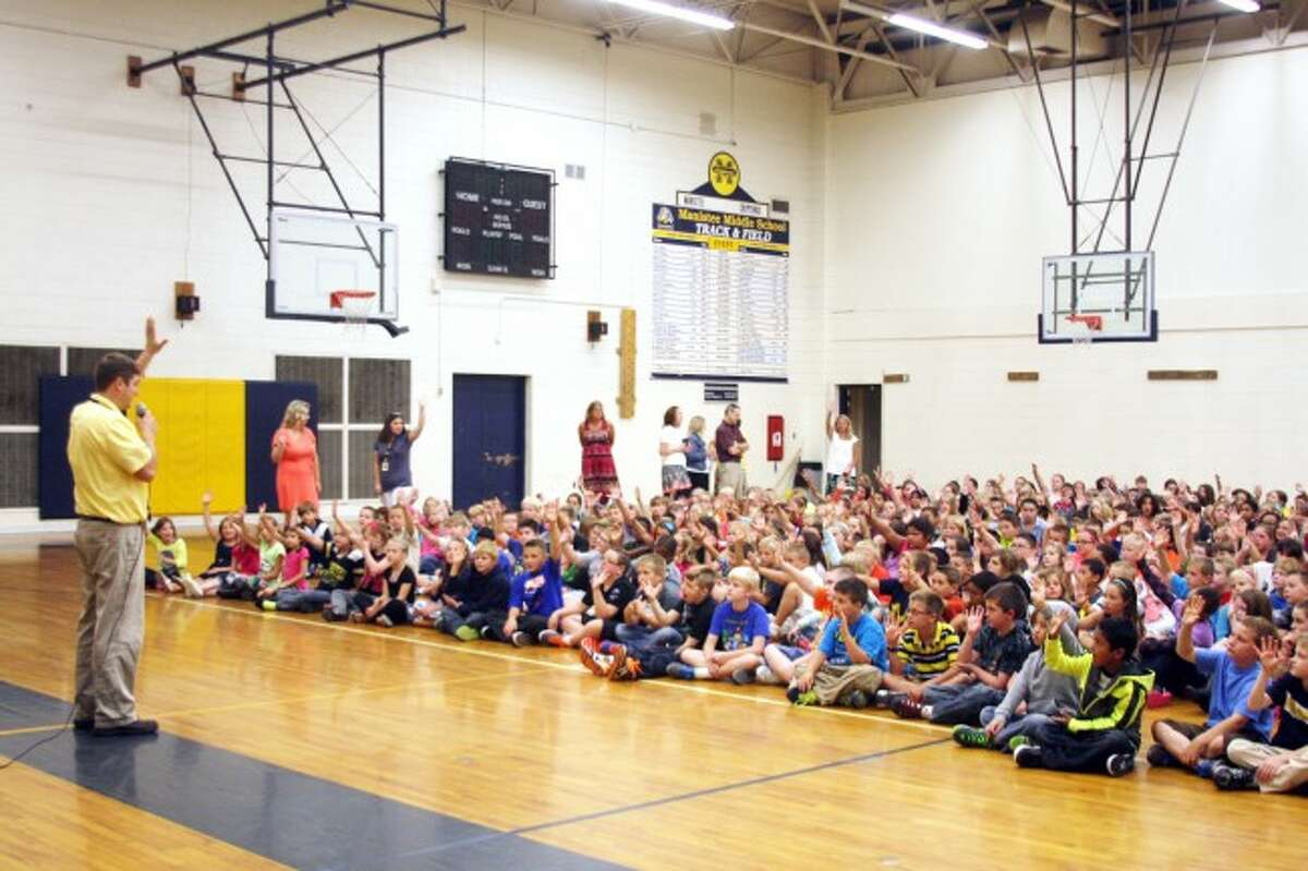 Kennedy Elementary Principal Kevin Schmuztler welcomes all the students back for the first day of classes.