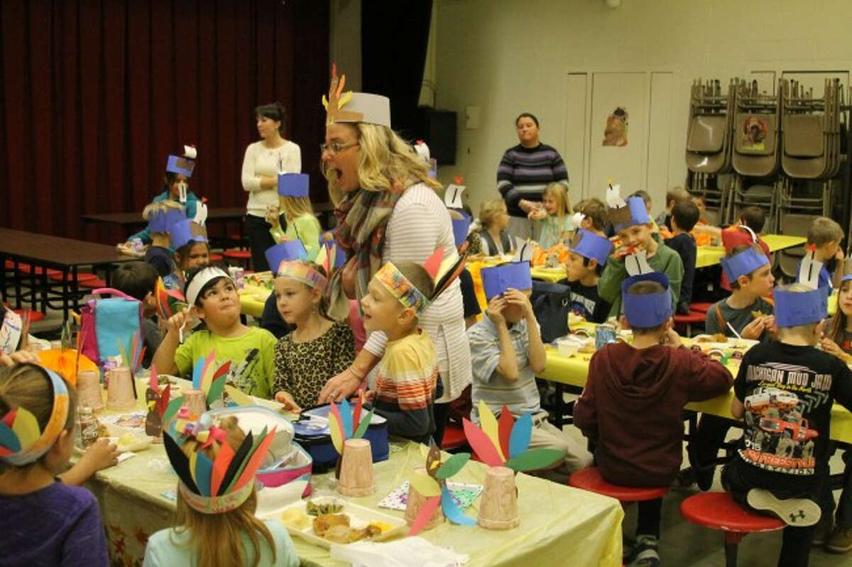 Bear Lake principal Sarah Harless shares some laughs with students at the Thanksgiving feast on Thursday at the school. Students learned about the true meaning of the holiday and celebrating fellowship with friends.
