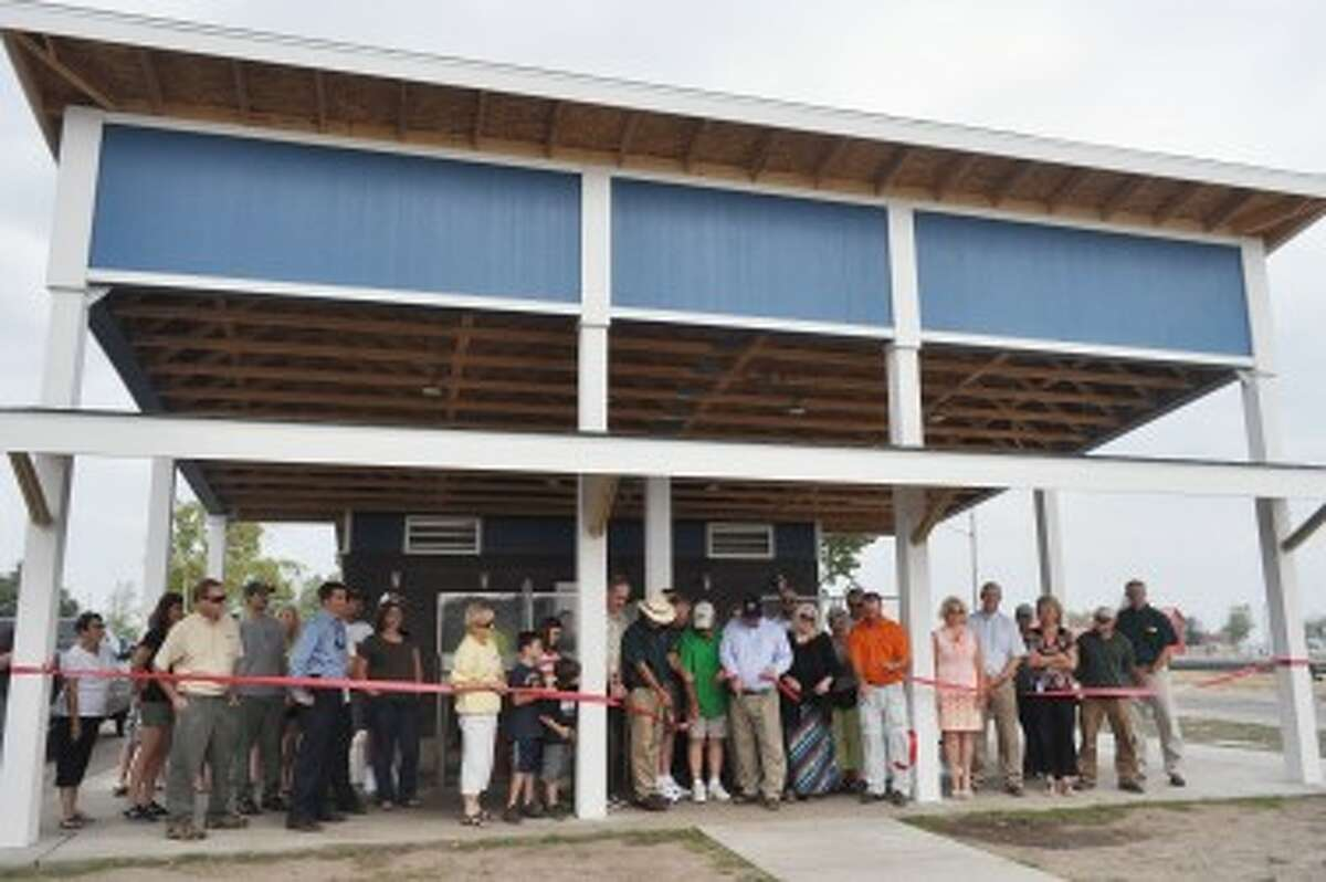 Dozens gathered for the dedication of the new First Street Beach fish cleaning station on Wednesday.