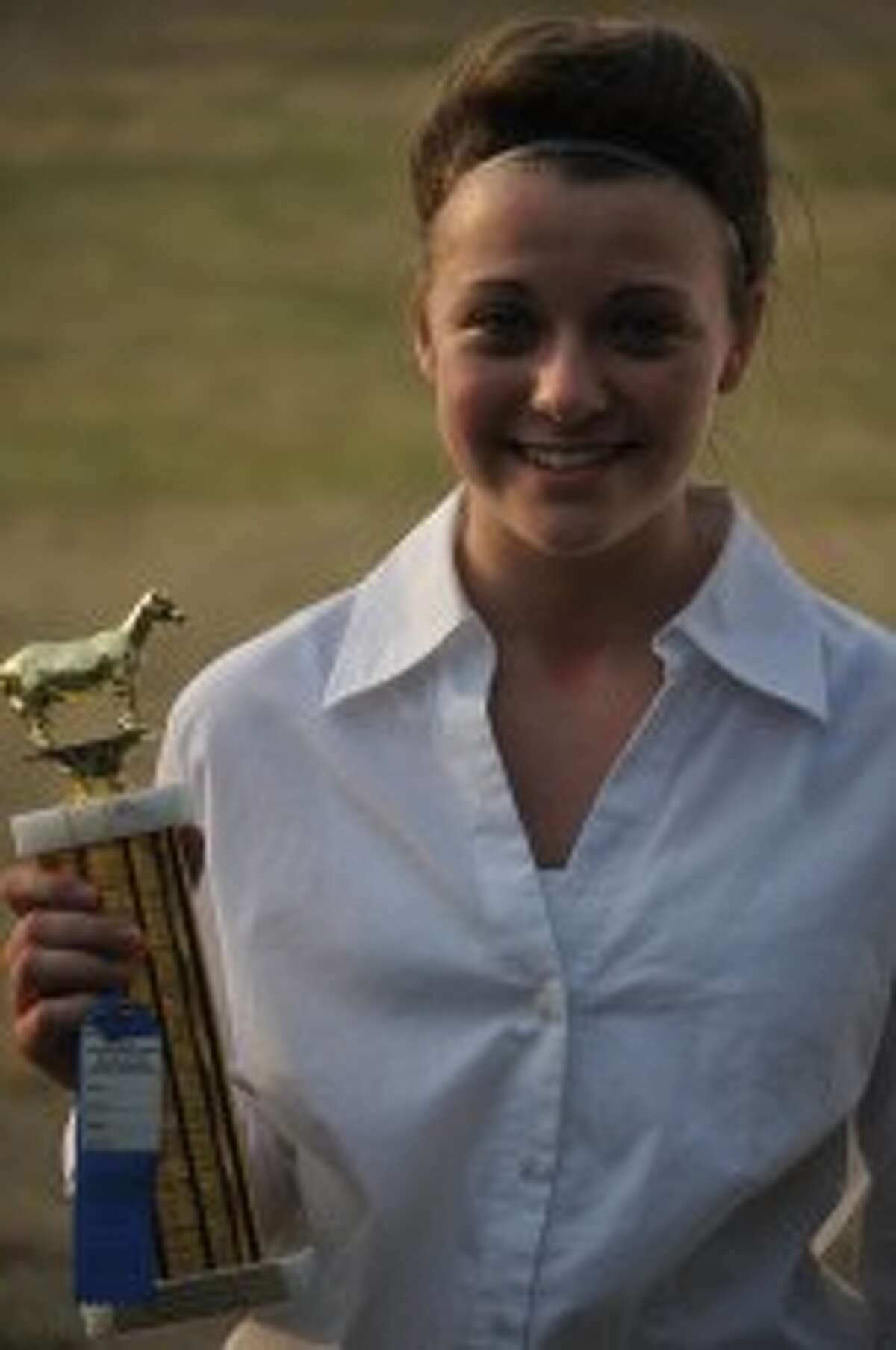 Breanna Buckner won in her class during the goat judging on Wednesday at the Manistee County Fair.