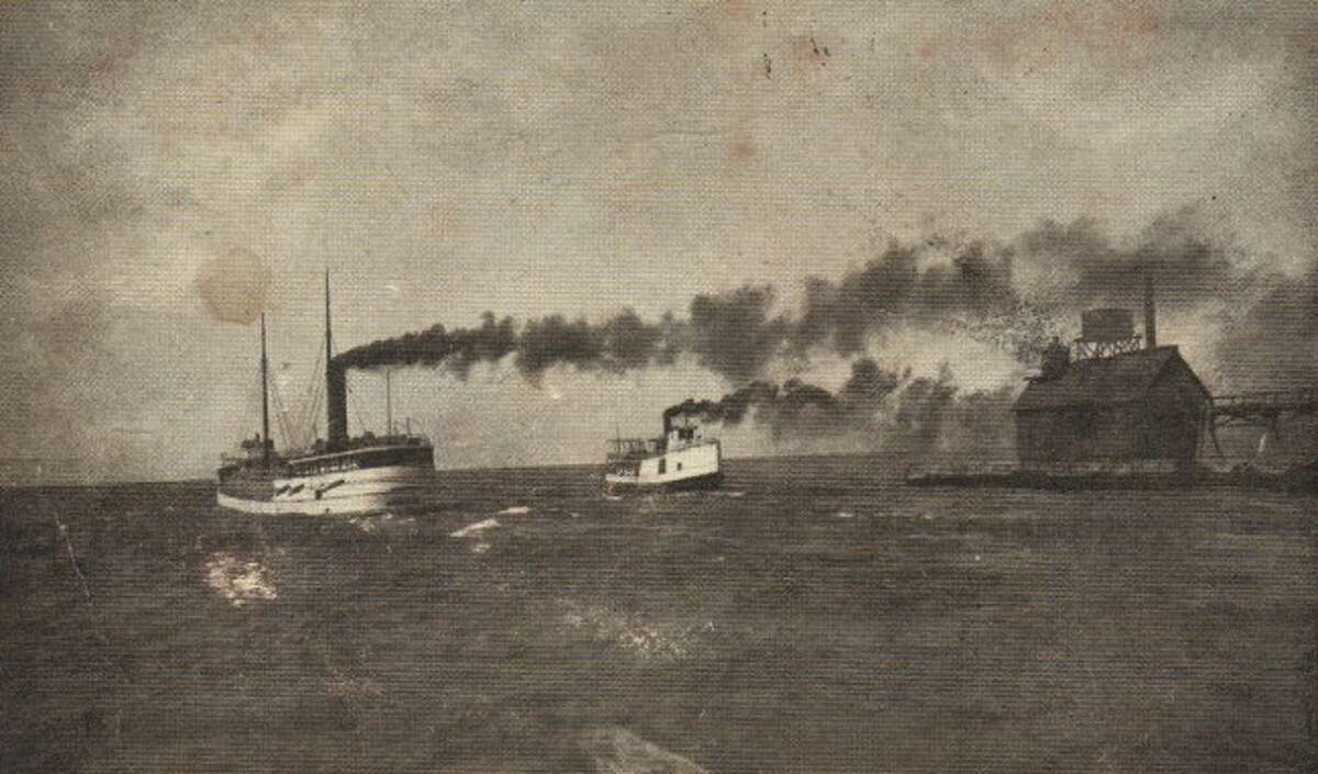 A steamer and tug pass the Fifth Avenue beach pier in this early 1900 depiction.