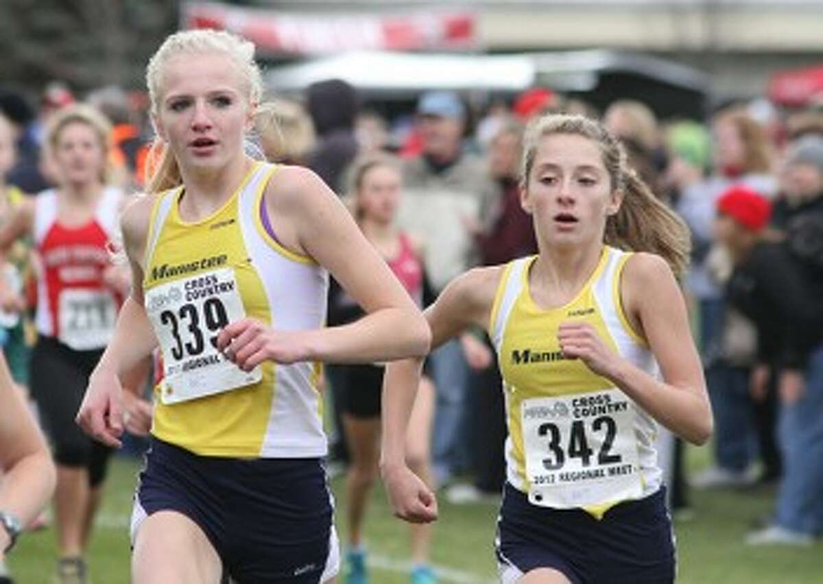 Manistee junior Annie Fuller (left) and sophomore Ashley Lindeman were both All-State runners last season while finishing in the top 15 at the Division 3 state finals. The duo leads a talented group of runners this season. (Matt Wenzel/News Advocate file photo)