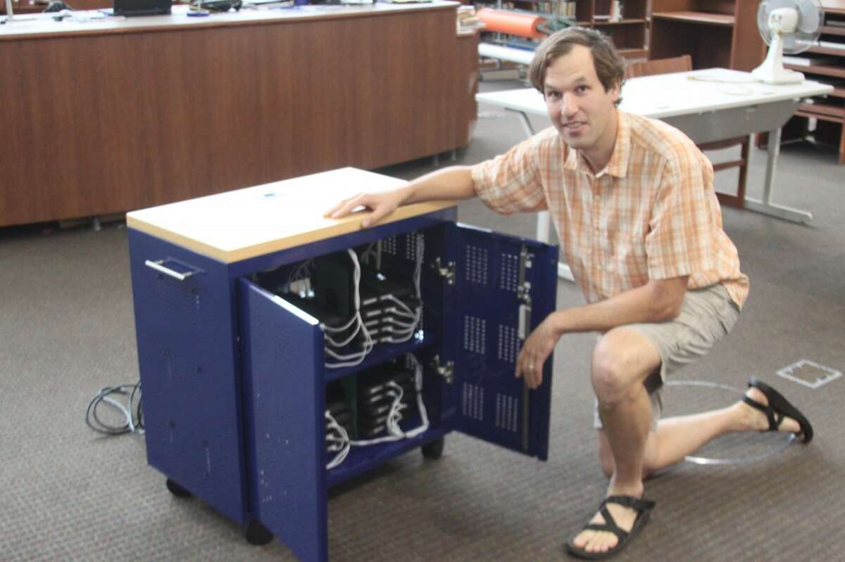 MAPS technology director Ken Blakey-Shell shows one of the iPad cabinets that were created by Metalworks and Fab Lite for the school district.