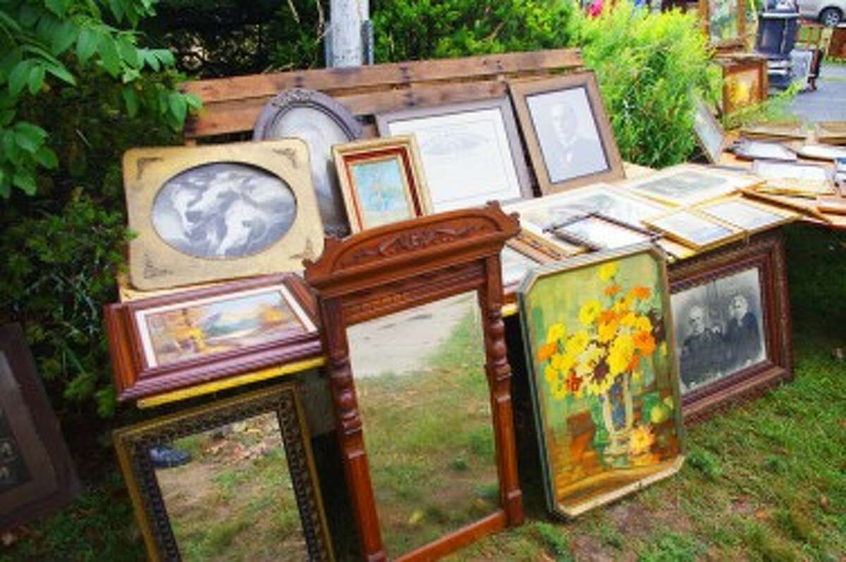There were so many items at the Harold Kaap estate sale, including vintage artwork and furnishings, that most of those attending brought lawn chairs. The sale was held Thursday in Parkdale. (Dave Yarnell/News Advocate)