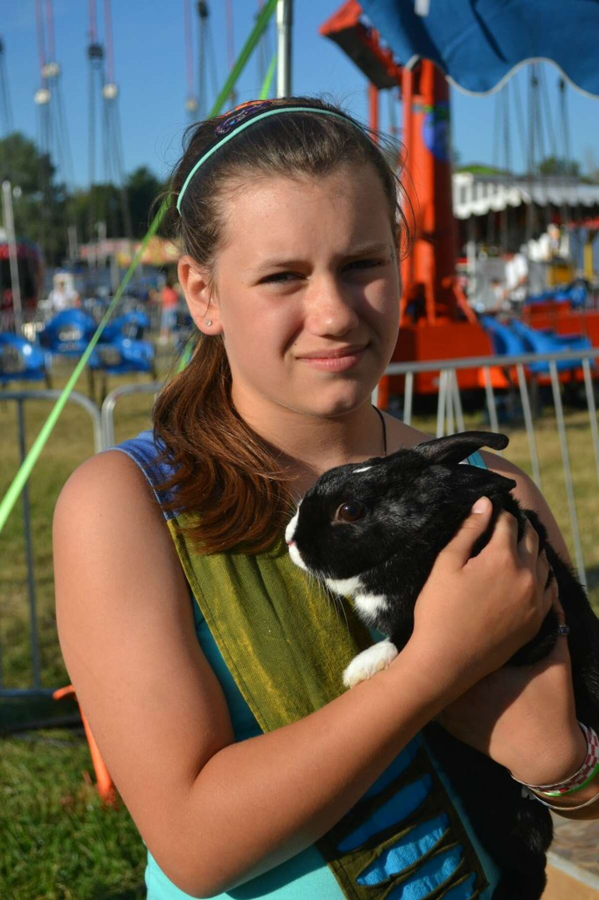 Savannah Rogers wrote a report about her pet rabbit for the 4-H animal companion interview. (Meg LeDuc/News Advocate)
