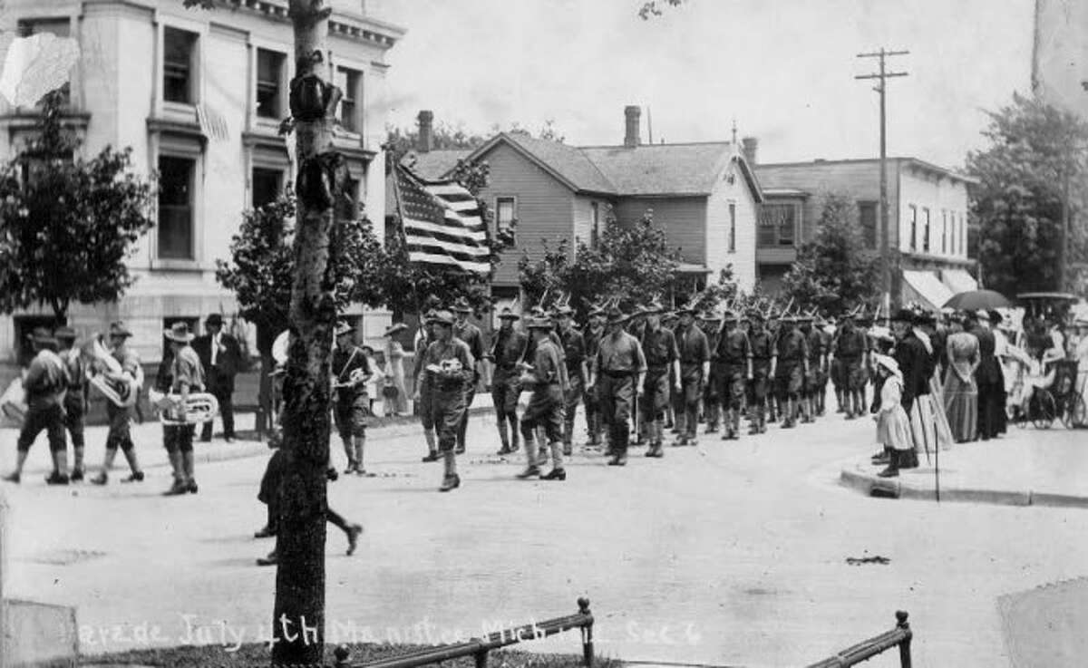 The Fourth of July parade travels across First Street in 1912.