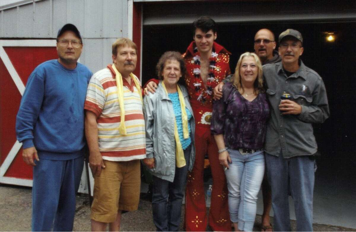 Elvis tribute artist Jake Slater puts his arm around Dorothy Conklin at the Conklin family reunion held in memory of Dorothy's husband, Kenneth Conklin Sr. (Courtesy Photo)
