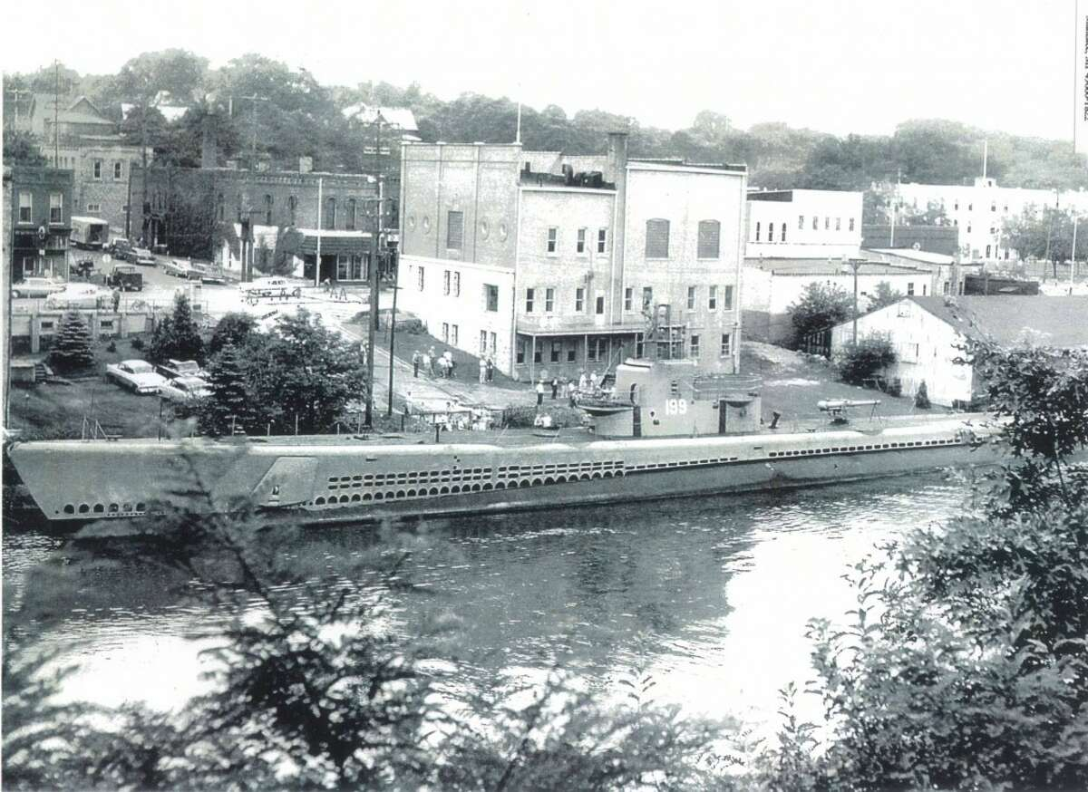 The U.S. Navy submarine Tautog, a heroic World War II vessel, was scrapped out in Manistee, but before it was citizens were invited to come on board for a tour. (Dave Yarnell/News Advocate)