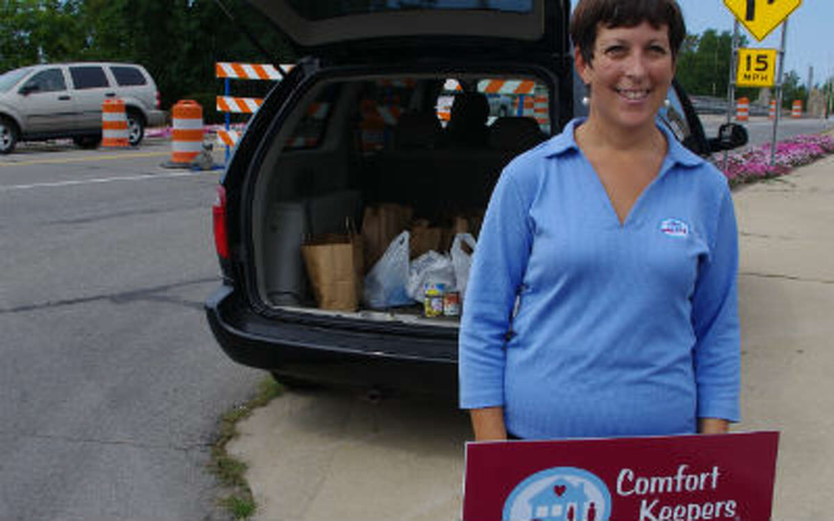 Comfort Keepers of Northern Lower Michigan gathered food Wednesday in front of the Manistee Area Chamber of Commerce to help stock the Manistee County Council on Aging pantry. The event was called a