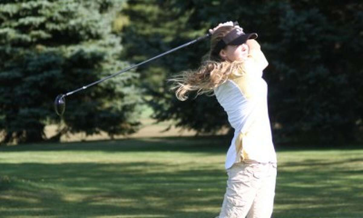 Manistee freshman Fallon Gates stares down her tee shot on the par-4 second hole at Manistee Golf & Country Club during Wednesday's match against Ludington. (Matt Wenzel/News Advocate)