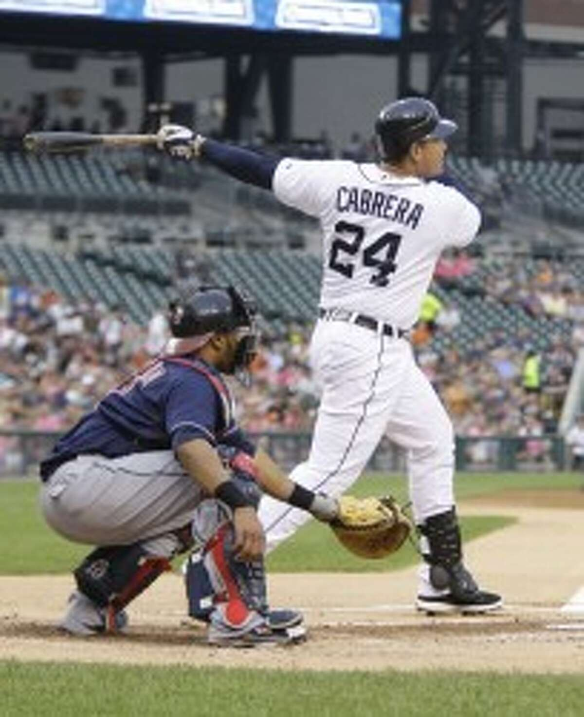 Tigers third baseman Miguel Cabrera hits a two-run homer in the first inning against the Cleveland Indians in Detroit on Wednesday. (Julian H. Gonzalez/Detroit Free Press/MCT)