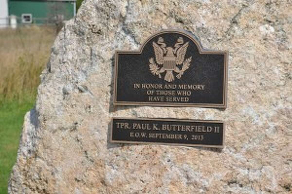 A memorial was set up outside fallen Michigan State Police Trooper Paul Butterfield's mobile office at the Pere Marquette Township Fire Department.