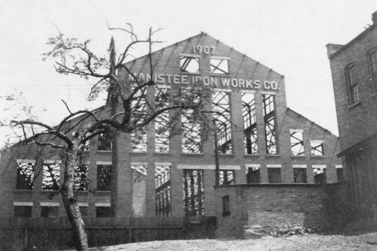 The Manistee Iron Works building is shown being constructed in 1907.