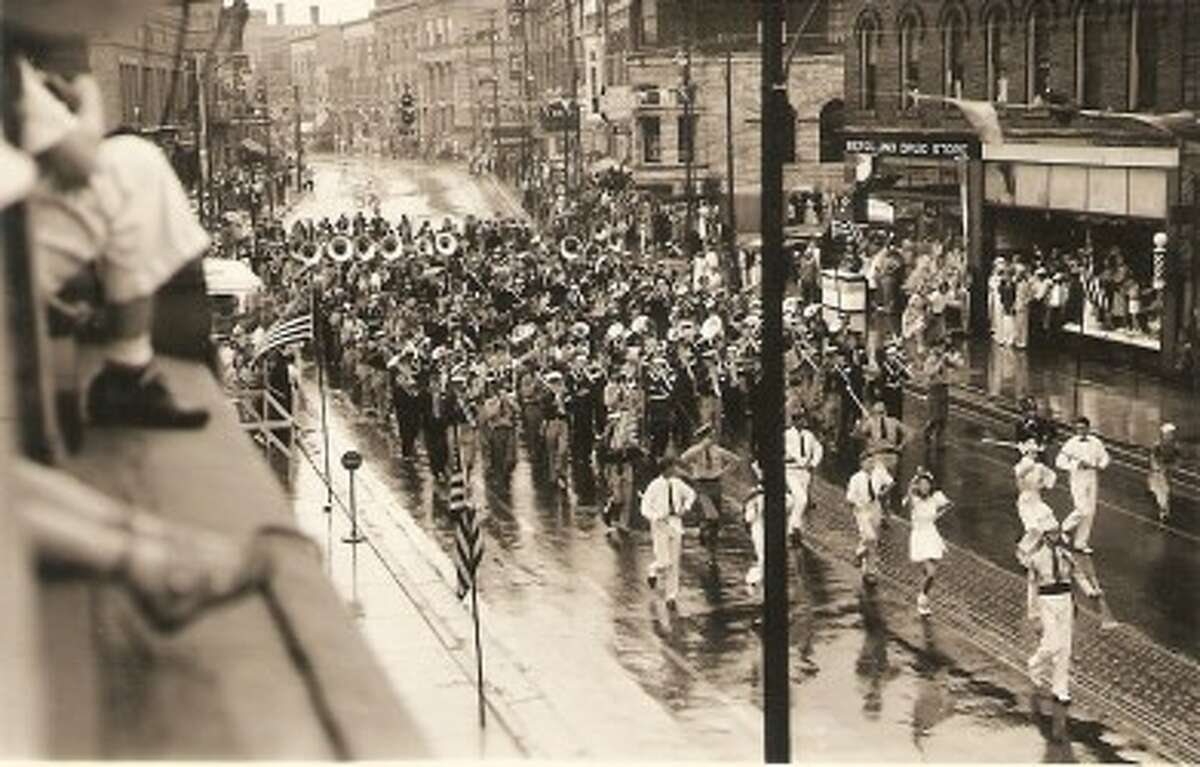 A marching band travels down River Street in the 1930s. (Courtesy Photo/Dale Picardat)