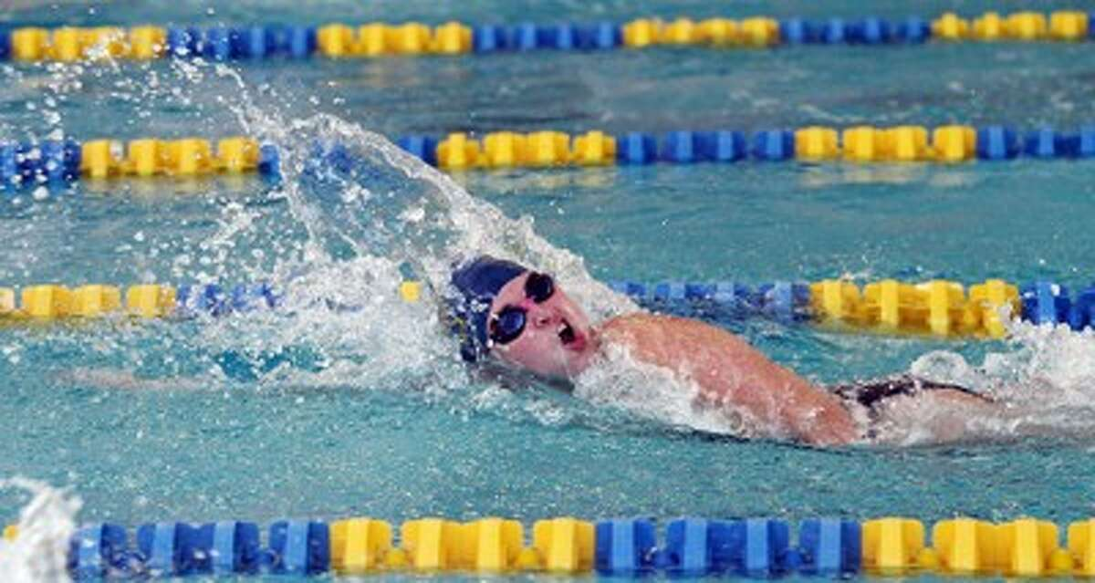 Manistee senior Sara Wehrmeister swims the final leg of the 200-yard freestyle relay en route to a Division 3 state qualifying time during Wednesday's win against Muskegon Catholic Central. (Dylan Savela/News Advocate)