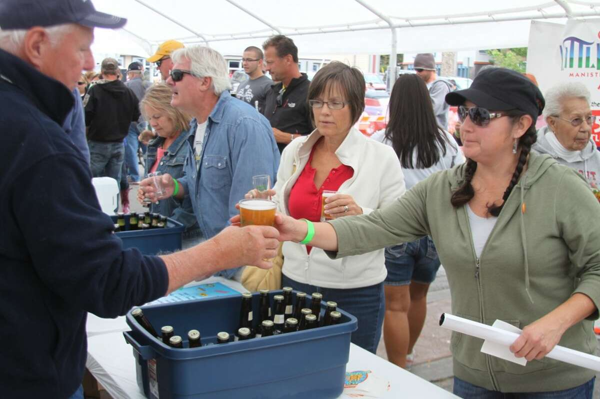 There were 20 different types of craft beer to enjoy at the Hops & Props By the River event and many people took the opportunity to give them a try. (News Advocate photo/Ken Grabowski)