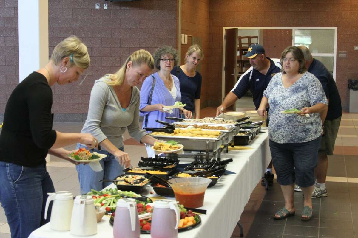Manistee Area Public School teachers held in-service programs on Thursday at the school and were treated to a buffet lunch. All the county schools kick-off the upcoming school year on Tuesday.(Ken Grabowski/News Advocate)