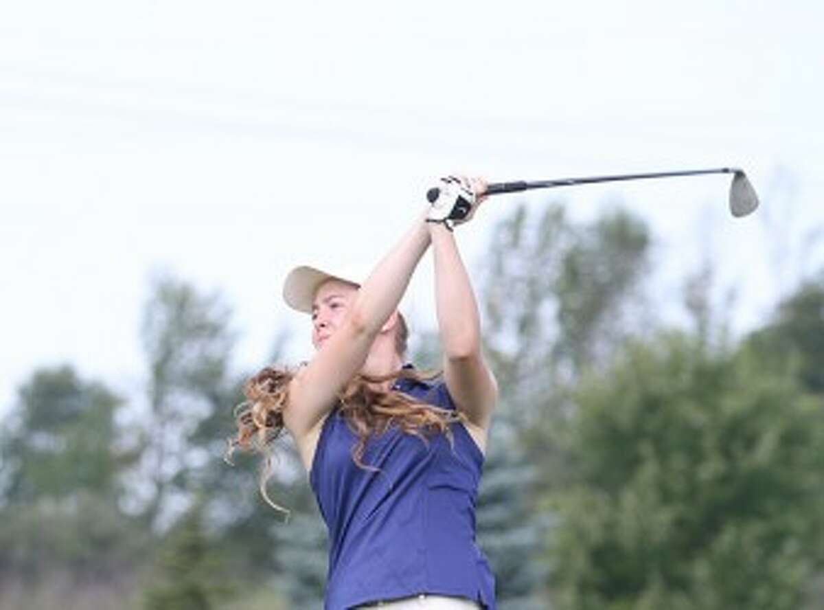 Manistee sophomore Fallon Gates watches her tee shot on No. 9 at Manistee National's Canthooke Valley during Thursday's match against Fremont. Gates shot a 1-over 37 for medalist honors. (Matt Wenzel/News Advocate)