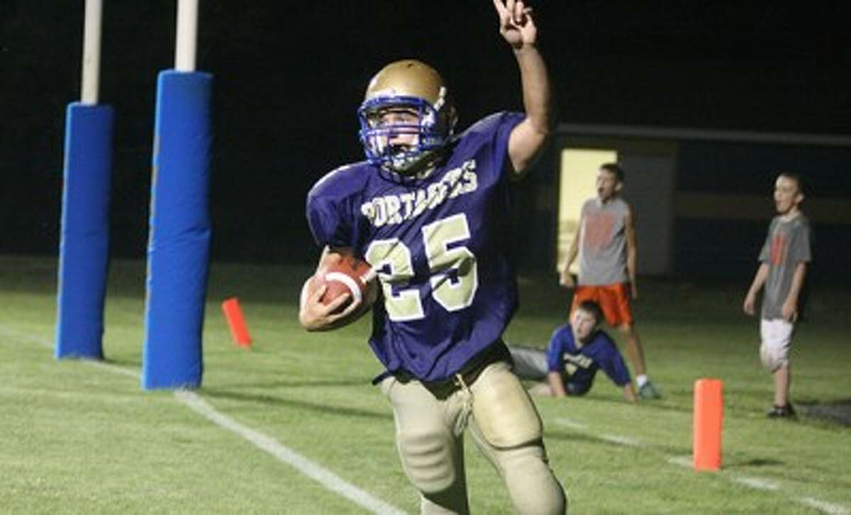 Onekama's Jordan Coe celebrates after scoring on a 2-point conversion in the second half of Thursday's win against Hart. (Dylan Savela/News Advocate)