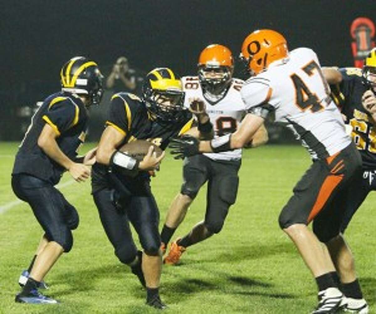 Manistee's Jake Williams looks for running room in the second half. (Matt Wenzel/News Advocate)