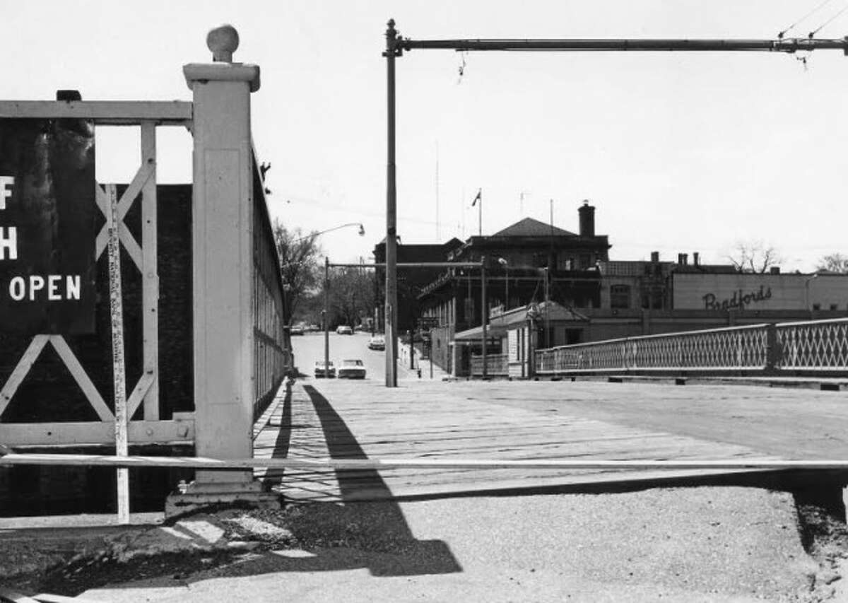 This 55-year-old photograph shows a view of what the Maple Street Bridge in 1960 prior to the construction of the present bridge.