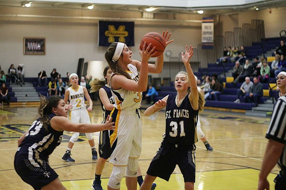 Brian Fogg/ News AdvocateSenior forward Emma Burns catches a pass and goes up for a layup in a victory over St. Francis on Thursday evening.