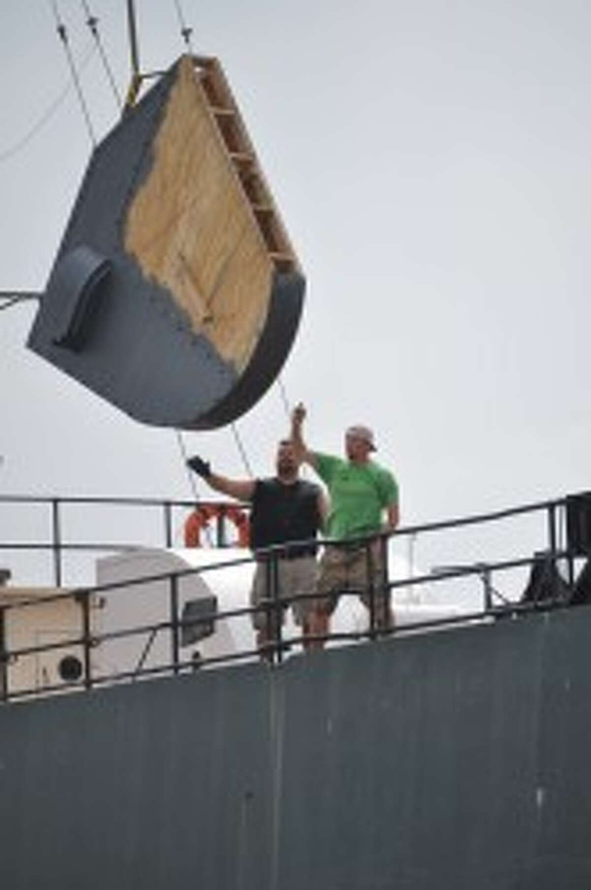 Writer, director and producer Harold Cronk and his crew members set up props for the new Mickey Matson movie on Friday at the S.S. City of Milwaukee in Manistee.