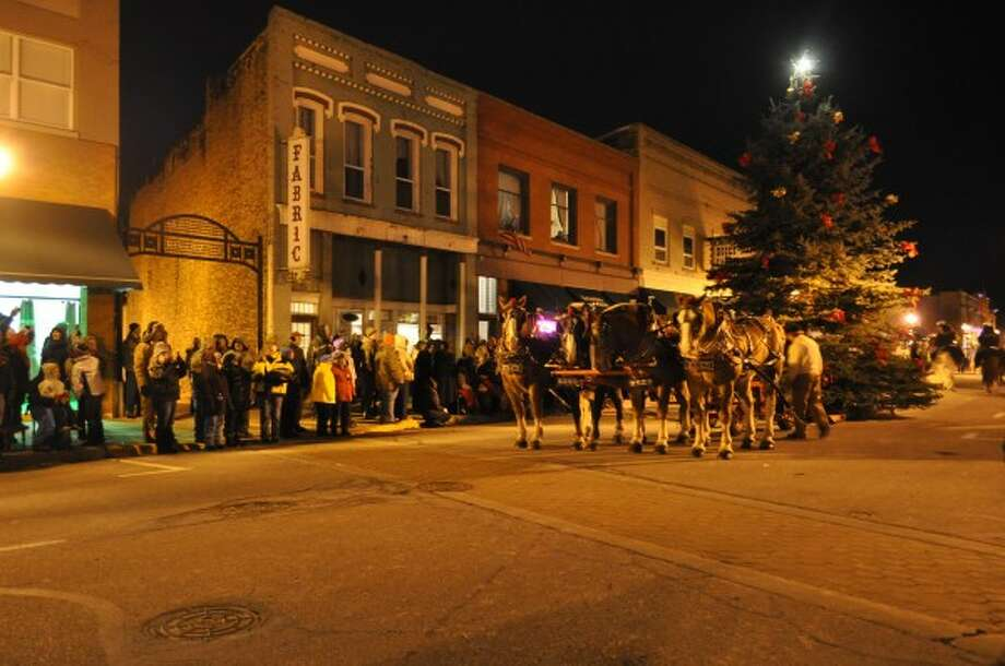 The City of Manistee's Christmas is carried down River Street during the 2013 Victorian Sleighbell Parade.