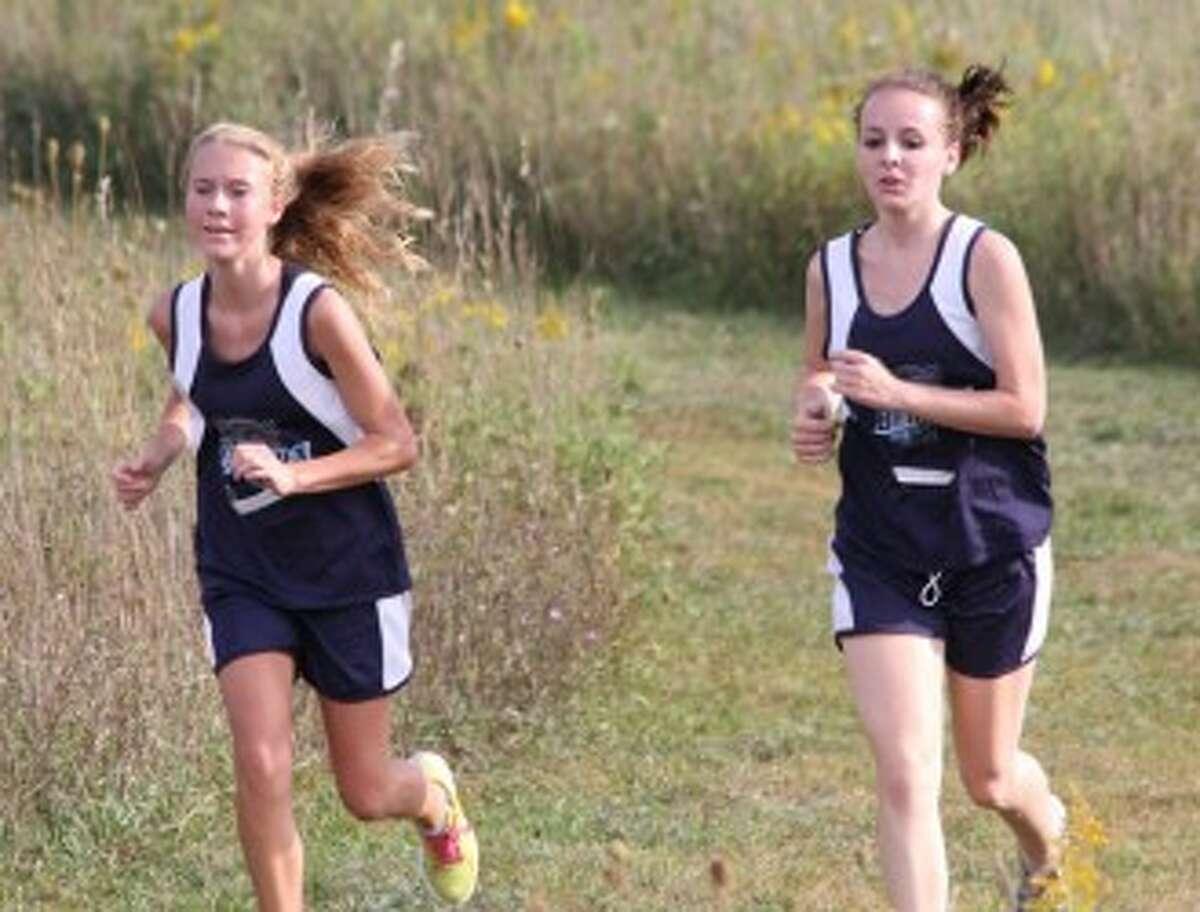 Brethren's Chloee Janssen (left) and Haley Tighe run during Wednesday's jamboree. (Matt Wenzel/News Advocate)