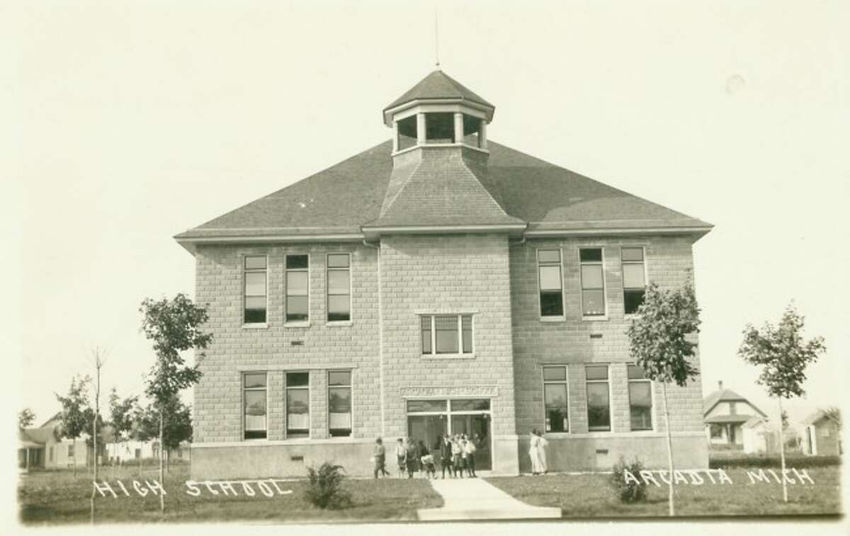 The Arcadia High School is shown with kids in front of it in this 1930s picture.
