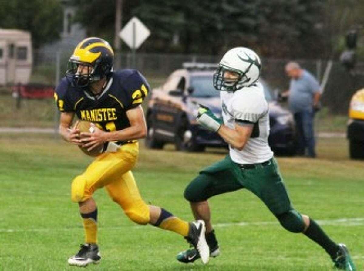 Manistee senior Evan Slawinski hauls in a 40-yard touchdown catch during Friday's win against Pine River. (Matt Wenzel/News Advocate)
