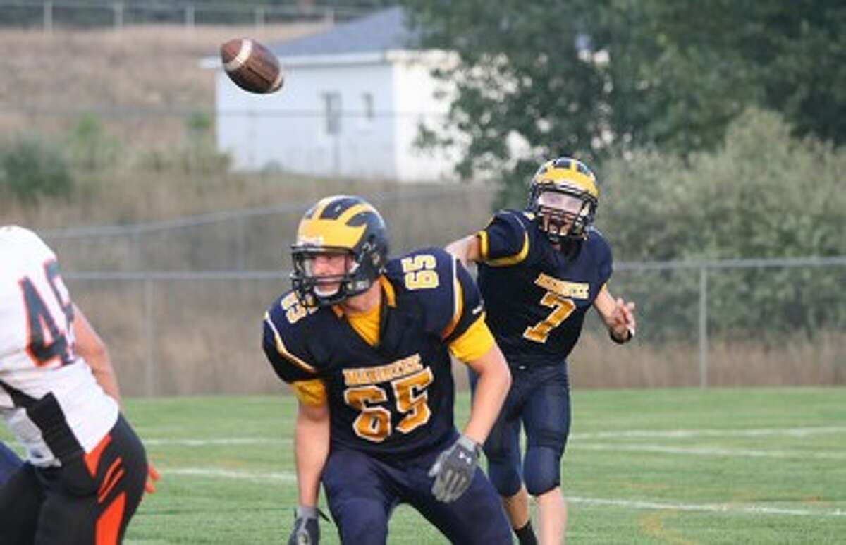 Manistee quarterback Tyler Kempf (7) throws a pass behind lineman Cameron Blevins during Thursday's loss to Ludington. (Matt Wenzel/News Advocate)