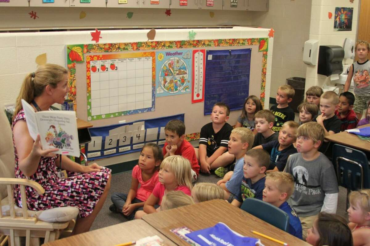 Onekama Consolidated Schools first grade students in Shantel Niederstadt's class listen to her read them a story on Wednesday afternoon. The Onekama Schools saw their enrollment numbers move up for the start of the 2013-14 school year. School officials throughout the county will be watching those numbers closely over the next several weeks leading up to the