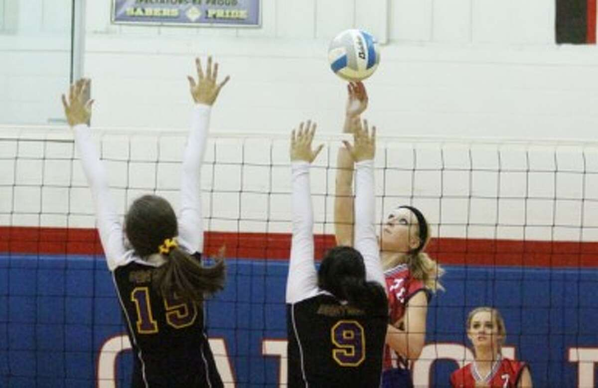 Manistee Catholic Central's Katie Pachesny (right) elevates for a spike during Thursday's win against Pentwater. (Matt Wenzel/News Advocate)