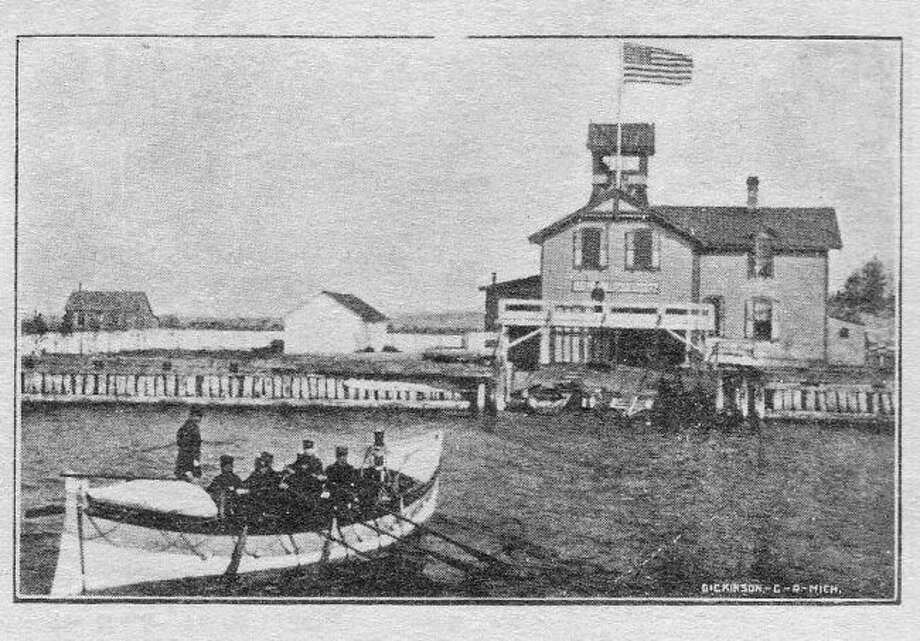 The Life Saving Station that was located at the mouth of the Manistee harbor is shown in this photograph from the early 1900s.