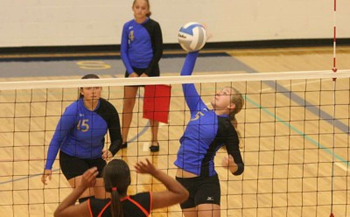 Onekama's Sydney Arendt elevates for a spike during Thursday's loss to Mesick. (Dylan Savela/News Advocate)