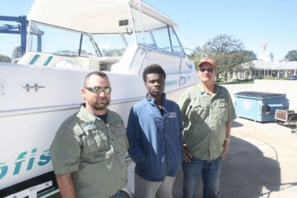 Pictured (from left to right): Larry Luckett, Andy Moten and Dave Acker of Midland's Fish Whisperer. (John Raffel/Pioneer News Network)