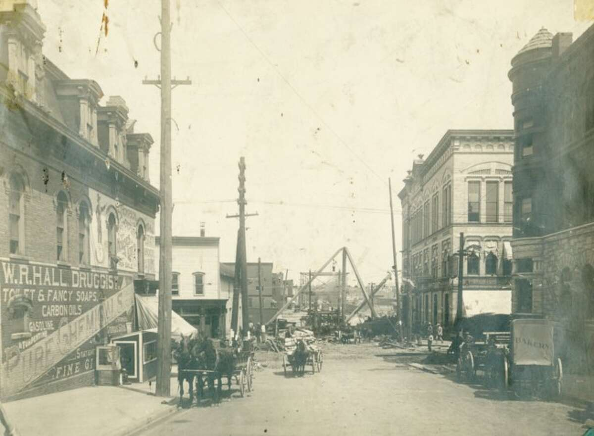 The view down Maple Street shows the bridge under construction in this early 1900s photograph. Some of the current buildings are still lining the road.
