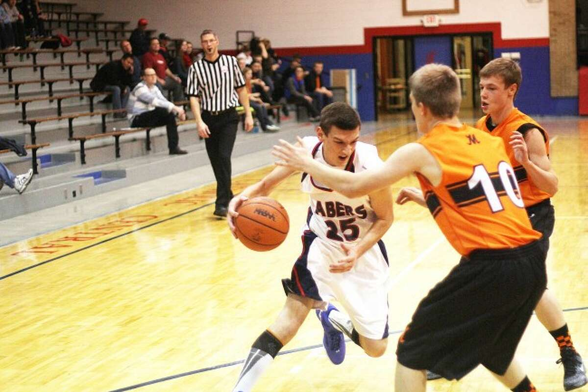 Brian Fogg/ News AdvocateAustin Vanaelst scored 23 points in the Sabers come-from-behind victory on Thursday night. They are now 1-1 on the season.